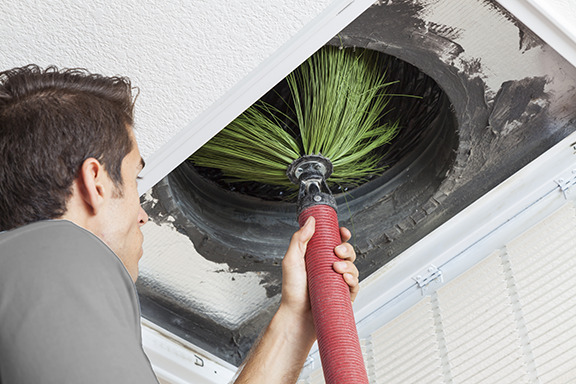 A tech sweeping out an air vent
