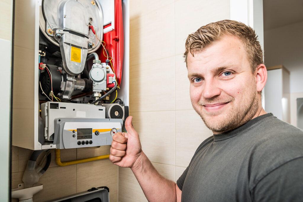 An HVAC technician giving a thumbs up